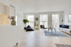 The living room is both bright and beautiful with the wooden floors and big windows.